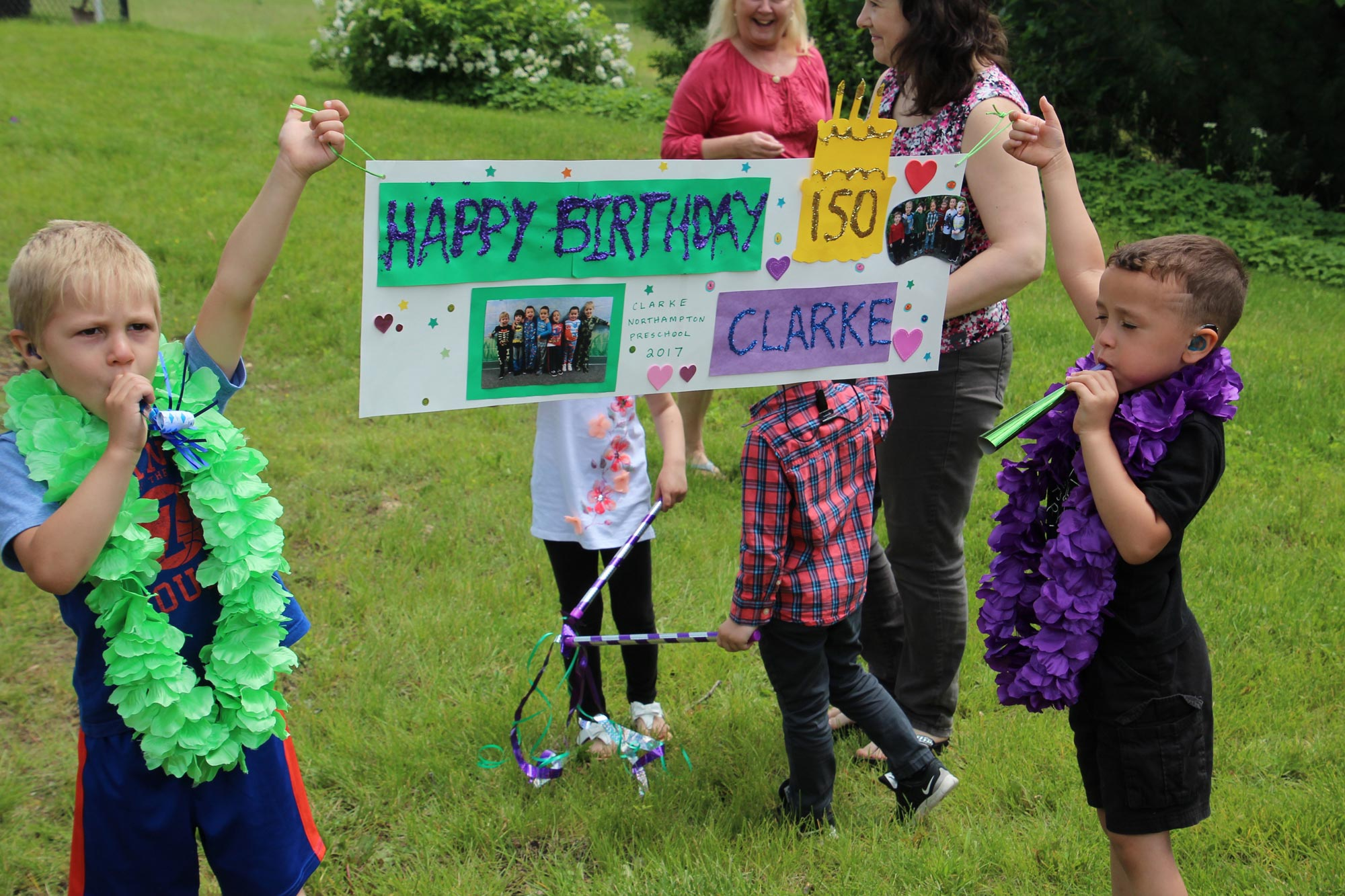 Clarke children hold 150th anniversary banner